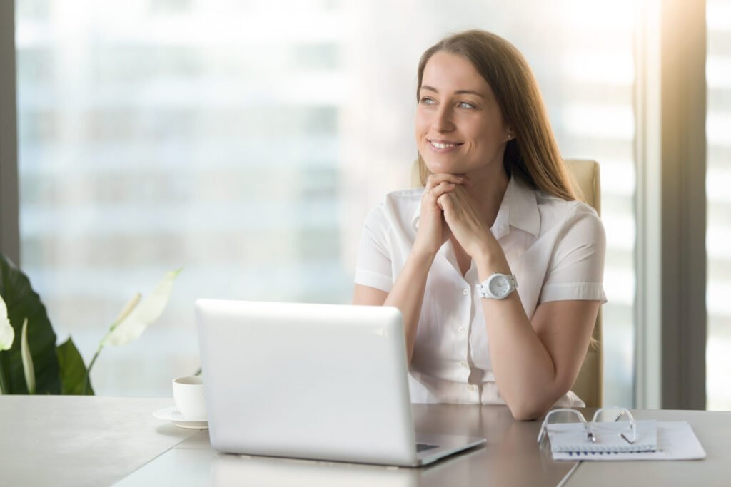 How to improve emotional intelligence at work: Image of a female executive reflecting on her day