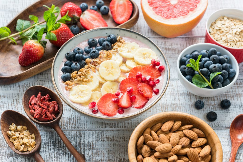How long does it take to break a habit: Image of bowls, plates and spoons along with healthy fruits and nuts.