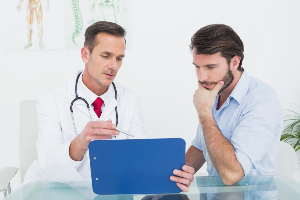 Blood test results: image of a doctor and a mail patient reviewing his test results